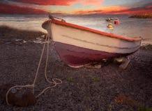 Barco del pescador en una orilla Imagen de archivo libre de regalías