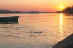 Barco en la salida del sol Imagen de archivo libre de regalías