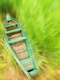Barco en un alto bastón Imagenes de archivo