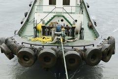 Barco experimental atado a la nave grande Foto de archivo