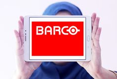 Barco manufacturer logo. Logo of Barco manufacturer on samsung tablet holded nby arab muslim woman. Barco NV is a technology company that develops sight, sound Stock Photo