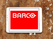 Barco manufacturer logo. Logo of Barco manufacturer on samsung tablet on wooden background. Barco NV is a technology company that develops sight, sound, and Royalty Free Stock Photo