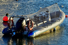 Barco na baía ocidental durante o por do sol Fotografia de Stock