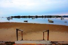Barco na maré baixa Imagem de Stock