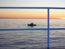 Barco no por do sol Imagens de Stock