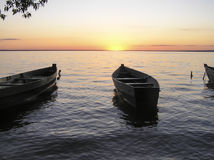 Barco no rio O por do sol Foto de Stock Royalty Free