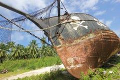 Barco pirata viejo oxidado Seychelles Fotos de archivo