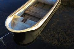 Barco plástico con el piso de los tableros fotografía de archivo libre de regalías