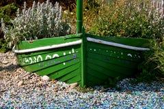 Barco verde con las flores Fotos de archivo libres de regalías