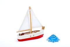 Barco y shell del juguete Imagen de archivo libre de regalías
