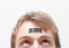 Barcode. On a man's forehead royalty free stock photo