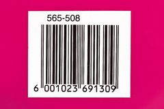 Barcode. Used barcode on a pink background with numbers stock image
