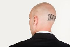 Barcode on back. Back of male head slightly turning with barcode stock image