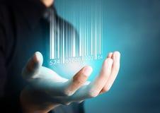 Barcode, der auf Geschäftsmannhand fällt Lizenzfreie Stockfotos
