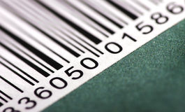 Barcode on green background. Close up view of a portion of a barcode on a green background stock photos