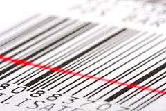 Barcode label. Barcode label with red laser beam. Macro shot, shallow DOF. Perfect background for your warehouse concepts artwork royalty free stock photography