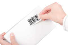 Barcode label. Sticking barcode label on white box Royalty Free Stock Images