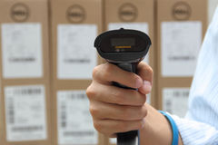 Barcode label scanner with label. On the boxes background Royalty Free Stock Images