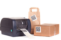 Barcode printer and packaging boxes. Marked with a bar code Royalty Free Stock Images