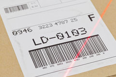 Barcode scan. Barcode on shipping label on box scanned by automatic laser scanner royalty free stock photo