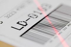 Barcode scan. Barcode on shipping label on box scanned by automatic laser scanner royalty free stock images