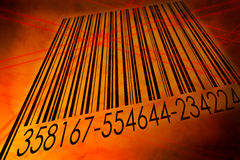 Barcode scanned by barcode laser reader Royalty Free Stock Images