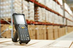 Barcode scanner at warehouse. Bluetooth barcode scanner in front of modern warehouse royalty free stock images