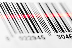 Barcode scanning. Barcode scanned by laser reader closeup royalty free stock photography
