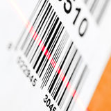 Barcode scanning. Barcode scanned by laser reader closeup royalty free stock photo