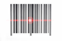 Barcode scanning red beam on white background. Royalty Free Stock Photo
