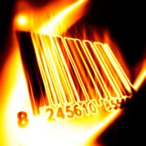 Barcode surrounded by fire. On a black background Royalty Free Stock Photos