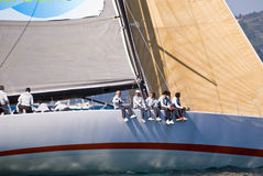 Barcolana. Team / crew on a boat sailing during regatta Barcolana in a sunny day - (Trieste, Italy 2007 Stock Photo