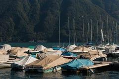 Barcos amarrados en el lago Lugano Imagenes de archivo