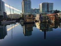Barcos de casa en la salida del sol Fotos de archivo