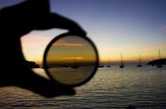 Barcos de la puesta del sol Fotos de archivo libres de regalías