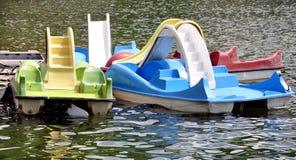 Barcos de pá na água Imagens de Stock Royalty Free