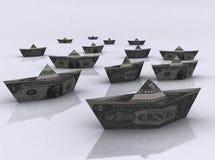 Barcos de papel feitos das notas de dólar Fotos de Stock