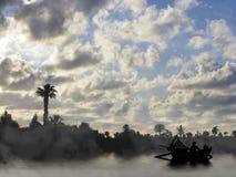 Barcos de pesca no nascer do sol Imagem de Stock Royalty Free