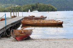 Barcos de rowing en el distrito del lago Windermere Imagen de archivo libre de regalías