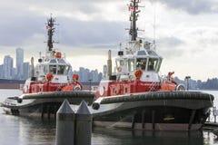 Barcos del tirón en de Vancouver el puerto A.C. Foto de archivo