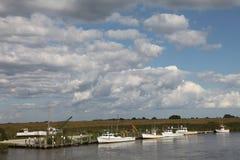 Barcos do caranguejo no rio de Smyrna Imagens de Stock