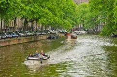 Barcos en el canal de Amsterdam Imagen de archivo