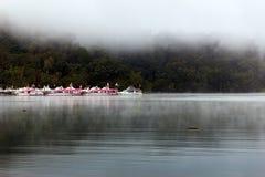 Barcos en el embarcadero de Ita Thao Fotos de archivo