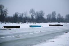 Barcos en el lago congelado Foto de archivo libre de regalías