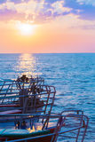 Barcos en el mar en puesta del sol Foto de archivo libre de regalías