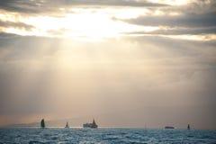 Barcos en la puesta del sol Fotografía de archivo