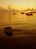 Barcos en la salida del sol Fotos de archivo libres de regalías