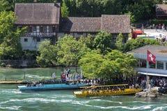 Barcos en Rhine Falls Foto de archivo libre de regalías