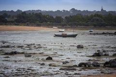 Barcos na maré baixa Imagens de Stock