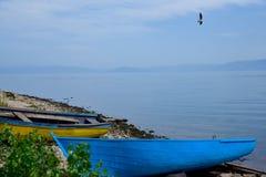 Barcos na praia Imagens de Stock